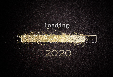 2020 New year background with loading bar of sparkling gold glitter counting down to the new year over a black background with copy space