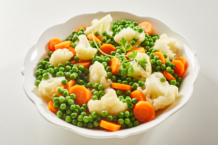 Mixed steamed young vegetables served as a side dish to the meal viewed close up for a menu or advertising