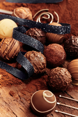 Selection of different handmade chocolate balls with an elegant black ribbon for a gift or present Stock Photo - 115257877