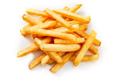 Heap of golden oven baked potato chips or French Fries on a white background for a tasty snack or accompaniment to a meal