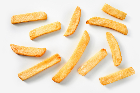 Homemade deep fried French fries on a white background in a random scatter viewed from above Stock Photo