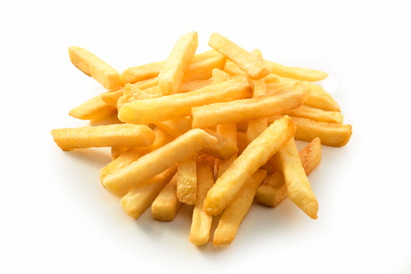Stack of golden crispy deep fried potato chips, French Fries or Pommes Frites close up on a white background for menu advertising