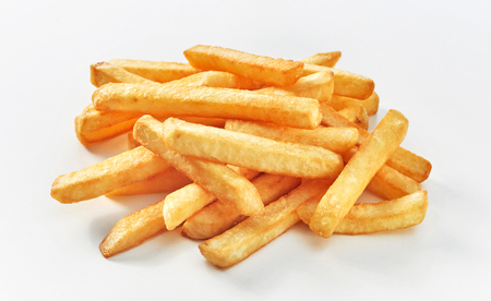 Stack of middle cut french fries on white background. Stock Photo