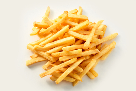 Fresh oven baked healthy potato chips, french Fries or Pommes Frites in a pile on white for a menu