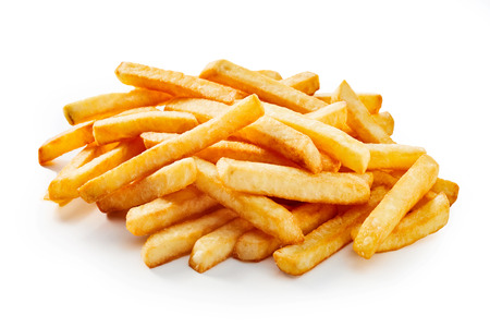 Stack of fresh fried french fries in depth perspective as construction material or visualisation of unhealthy food.
