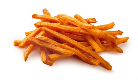 Stack or pile of spicy sweet potato french fries or chips on white background.