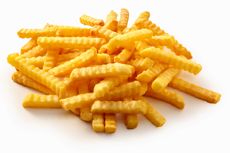 Heap of crispy golden crinkle cut potato chips or Pommes Frites on a white background for a menu Stock Photo