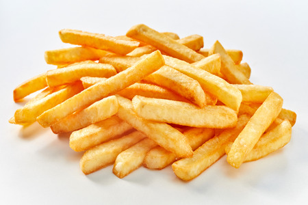 Heap of long french fries on white background.