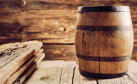 Oak barrel for alcohol aging, standing on old wooden table in rustic house. Copy space Фото со стока - 115258068