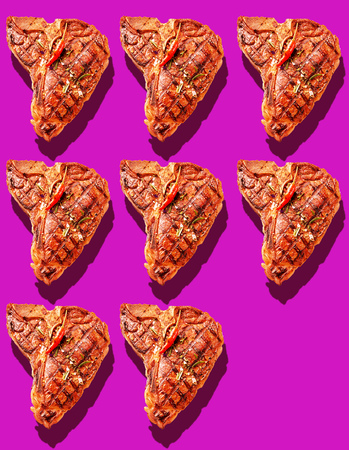 Eight grilled marinated T-bone steaks with hot red chili pepper garnish on bright magenta background with copy space and drop shadows