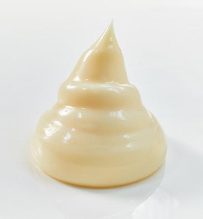 Single mayonnaise tower for stylish food presentation on a white background