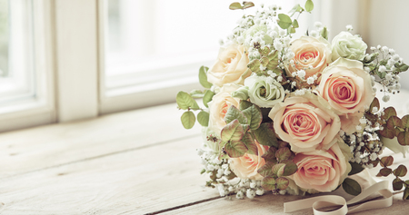 Bridal bouquet of pink roses idea with copy space on window sill Stock Photo