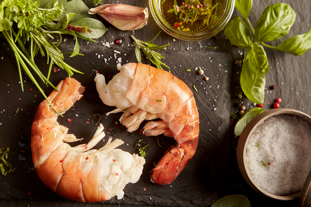 Fresh prawn tails with herbs and salt ready to prepare a gourmet seafood starter Stock fotó