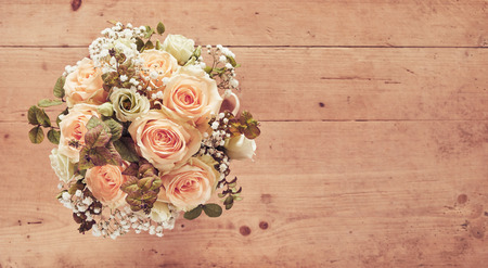 Wedding bouquet of pink roses on wooden background, viewed from above with copy space Stock fotó