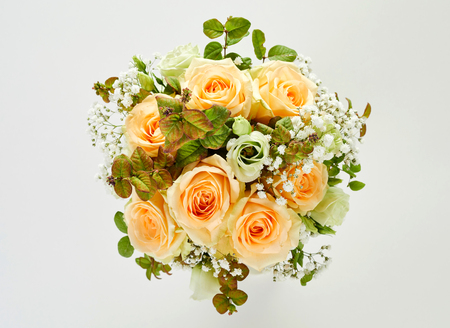 Beautiful wedding bouquet of roses, viewed in close-up from above on white background