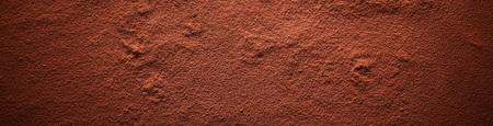 Banner de superficie de cacao en polvo, visto en fotograma completo desde arriba con efecto de viñeta oscurecida