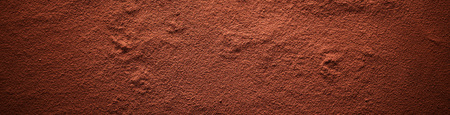Cocoa powder surface banner, viewed in full frame from above with darkened vignette effect