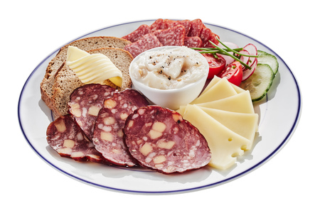 Plate of assorted spicy sausages and slices of cheese served with fresh rye bread, tomato and cucumber garnished with chives around a central dip or spread isolated on white for a menu