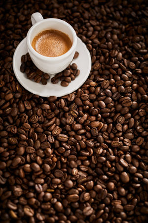 Roasted coffee bean with cup of espresso coffee