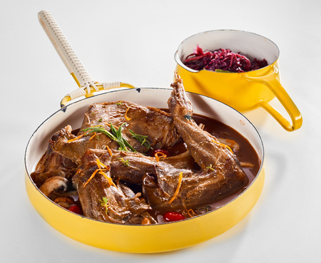 Wild rabbit stew with a pot of red cabbage as side dish