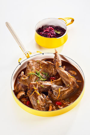 Wild rabbit stew with a pot of red cabbage as side dish Stock Photo