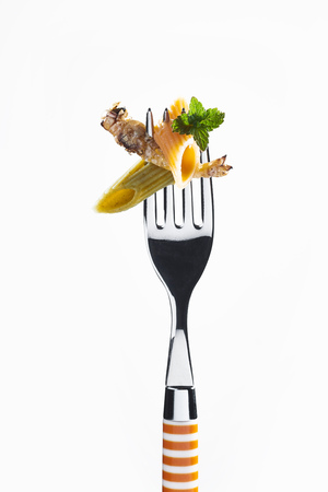 Italian penne pasta with fried caterpillar and mint presented on a striped fork isolated on white with copy space conceptual of nutrition from bugs and insects Stock Photo
