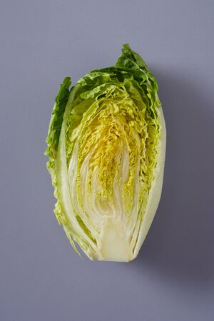 Cross section of fresh Chinese Cabbage or Napa Cabbage showing the arrangement of the crinkly green leaves over grey