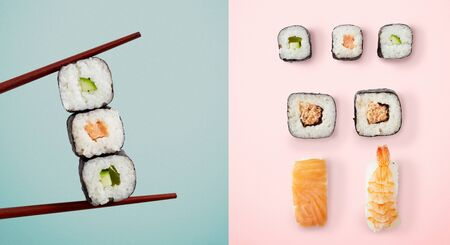 Chopsticks holding seaweed rolls filled with avocado and fish over blue and sushi over pink background