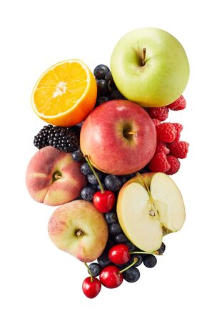 Wide assortment of organic halved and whole fruits including oranges and different colored apples on white surface