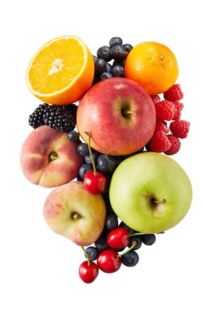 Single pile of assorted fruit including apples cherries halved oranges and peaches over white