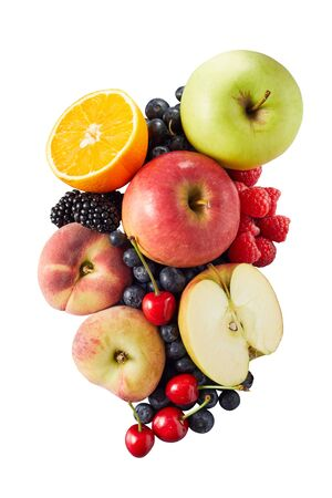 Several different halved and whole fruits including apples blueberries and oranges in pile on bright white backdrop