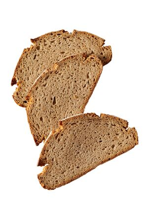 Three slices of healthy freshly baked rye bread isolated on white viewed as a flat lay from above with copy space