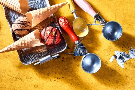 Wafer cones and ice cream scoops with two assorted flavors of Ice-cream viewed in a flat lay still life