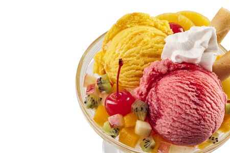 Close up of a colourful tropical ice-cream fruit sundae on a white background with copy space. 版權商用圖片