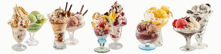 An assortment of various ice-cream sundaes on a white background with copy space.