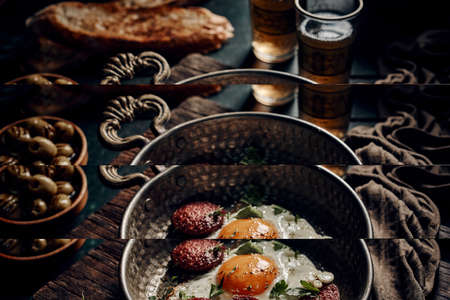 High angle of appetizing Sucuklu Yumurta with fried eggs and sausages with parsley placed on wooden board on table for traditional breakfast