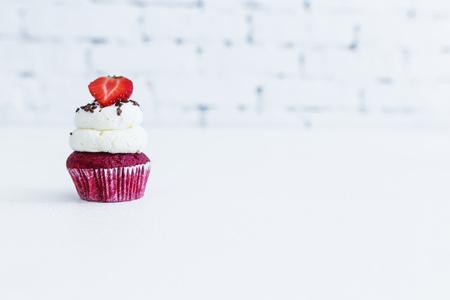 Red velvet capcake with mascarpone cream with strawberry.