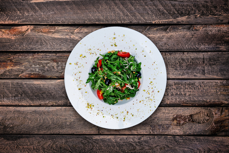 Rocket salad with cherry tomatoes Stock Photo
