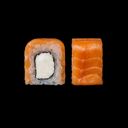Sushi. Philadelphia roll with salmon and cream cheese, isolated in black background Stock Photo