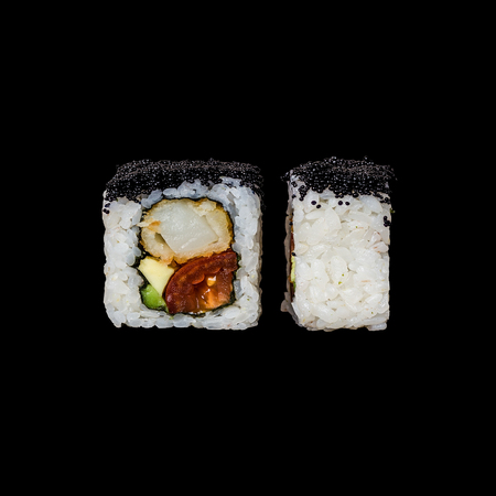 Sushi roll with shrimp, eel, avocado and tobiko, isolated in black background Stock Photo - 116459649