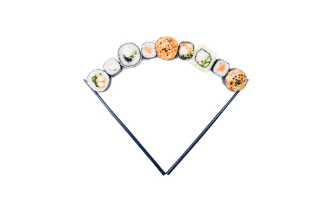 Sushi. Composition of assorted sushi rolls with chopsticks, isolated in white background