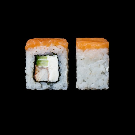 Sushi. Philadelphia roll with salmon, eel, cucumber and cream cheese, isolated in black background