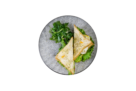 Sandwich with chicken and vegetables on a ceramic plate. Isolated on the white background, top view