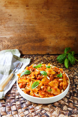 pasta sauce: plate of farfalle pasta with tomato sauce and basil Stock Photo