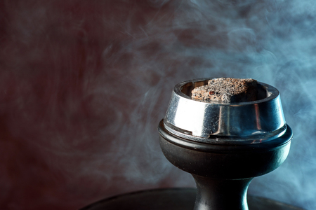 Shisha hookah with red hot coals. Sparks from breathe. Stock Photo