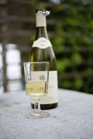 Bottle and glass of white wine Stock Photo - 15917797