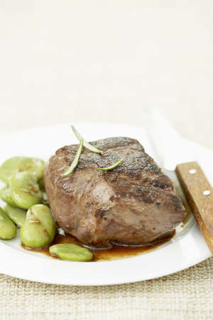 Thick piece of beef with fava beans Stock Photo - 15987458