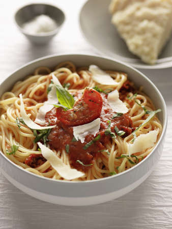Spaghettis with sun-dried tomato puree,basil and parmesan