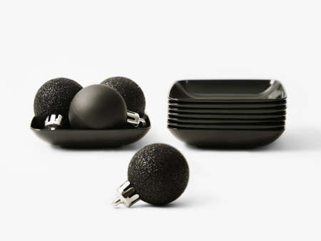 Black balls for the Christmas tree and small black dishes Stock Photo - 15987546