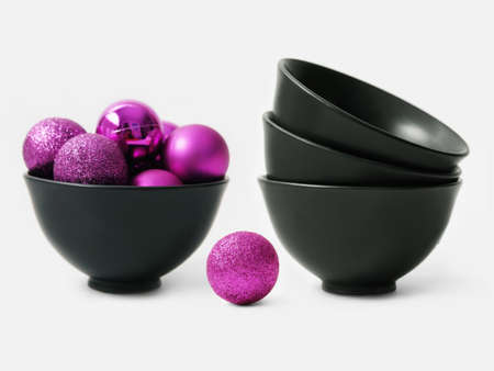 Purple balls for the Christmas tree and black bowls Stock Photo - 15987552